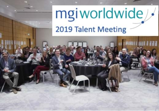 MGI World Meeting room image with MGI Worldwide logo and meeting name on white