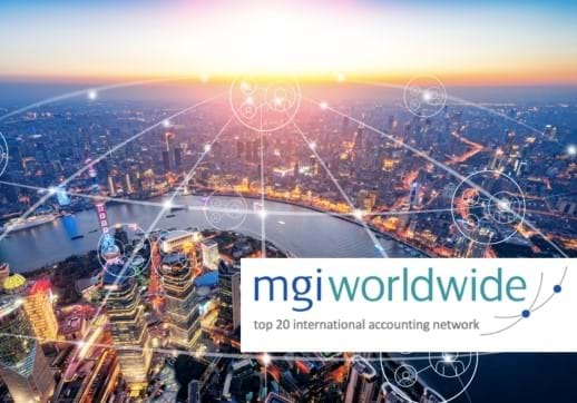 MGI World Cityscape with network overlay and MGI Worldwide logo and top 20 tagline