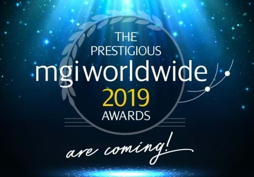 MGI World Stage spotlight shining on MGI Worldwide logo and words announcing 2019 awards