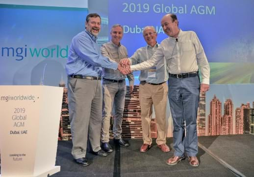MGI World MGI Worldwide accounting network and CPAAI MERGER picture - Jim, Michael, Clive, Roger shaking hands