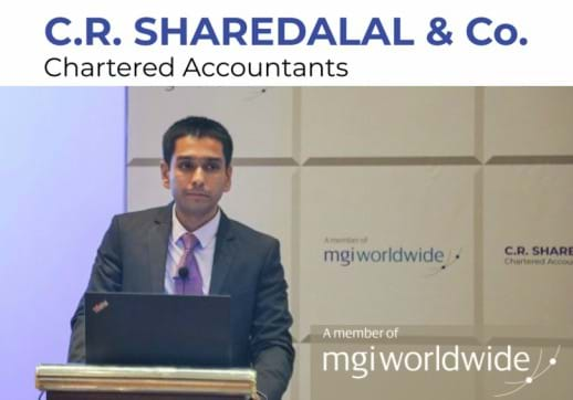 MGI World Anuj Sharedalal speaking at C.R. Sharedalal & Co's event announcing membership with MGI Worldwide