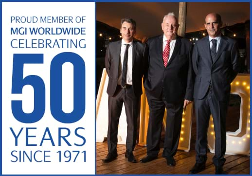 MGI World MGI Jebsen Anniversary lead image - three men in suits standing by 50 years icon