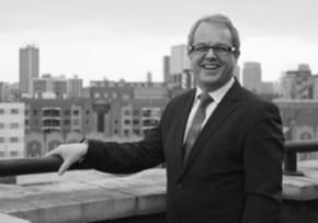 MGI World MGI Worldwide accounting network Newsroom item, Meet our new Chairman, black and white profile picture of Peter Winter on rooftop