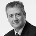 MGI World MGI Worldwide UK & Ireland Area member, chartered accountant firm Muras Baker Jones partner Chris Morris, black and white profile image