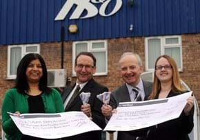 MGI World MGI Worldwide UK & Ireland Area news item, HBO charity donation, group with cheque image