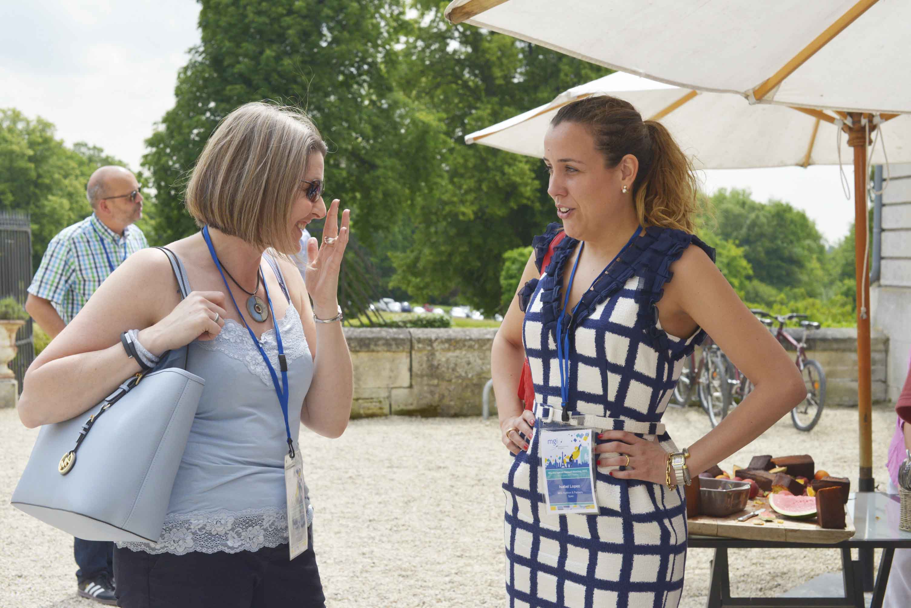 MGI World MGI Worldwide Europe Area Meeting 2015, Le Grand Mello, accounting delegates Rachel and Isabella on patio image