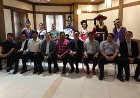 MGI World MGI Worldwide Asia Area meeting, 2015 Seoul, delegates with Koreans in traditional dress image