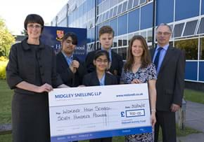 MGI World MGI Worldwide, UK & Ireland Area news item, member firm chartered accountants Midgley Snelling delivering cheque image