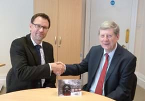 MGI World MGI Worldwide, UK & Ireland Area news item, member firm chartered accountants Seymour Taylor, two figures shaking hands image