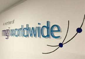MGI World MGI Worldwide, A Member Of wall logo